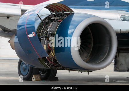 Close-up of a CFM International CFM56-7B turbofan jet engine on a Boeing 737-700 passenger airplane, with nacelle - Stock Photo