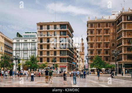 Valencia, Spain - June 3, 2016: Modern buildings on Plaza de la Virgen Cathedral Square in a central location of - Stock Photo