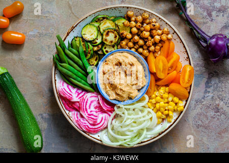 Vegan Buddha bowl with mixed vegetables - Stock Photo