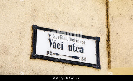 Street name sign on a wall, Vaci Utca, a famous shopping street in Pest, Budapest, capital city of Hungary, central - Stock Photo