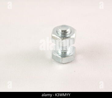 Bolt with nut on a white background - Stock Photo