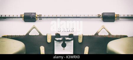 Close-up of word Sale on a typewriter sheet - Stock Photo