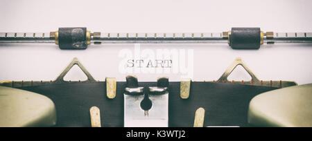 Close-up of word START on a typewriter sheet - Stock Photo