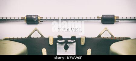Close-up of word TRAVEL on typewriter sheet - Stock Photo