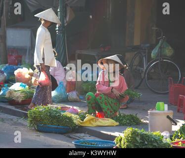 Saigon, Vietnam - June 2017: woman selling vegetables on street market, Saigon, Vietnam. - Stock Photo