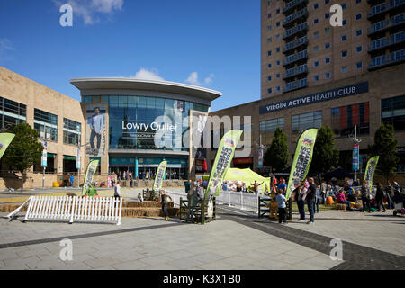 Regeneration docks area MediaCityUk at Salford Quays Gtr Manchester, Lowery Outlet mall discount shopping complex - Stock Photo