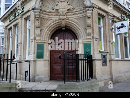 Stone arched doorway and double wooden doors on bank in llandudno north wales uk - Stock Photo