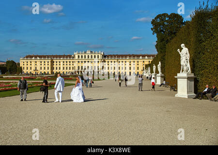 Vienna, Austria - September 24, 2014: Wedding photo shoot of bride and groom near Schonbrunn palace - Stock Photo