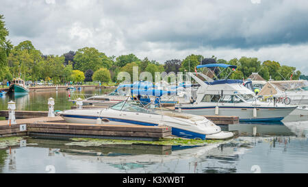 Small pleasure boats are safely docked in the Port of Orillia Ontario Canada as a late summer storm passes. - Stock Photo
