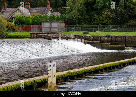 Spillway and tidal ford at Lopwell dam on  the River Tavy,Devon, UK - Stock Photo