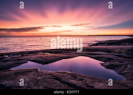 Epic sunset with beautiful color and sea at autumn evening in Porkkalanniemi, Finland - Stock Photo