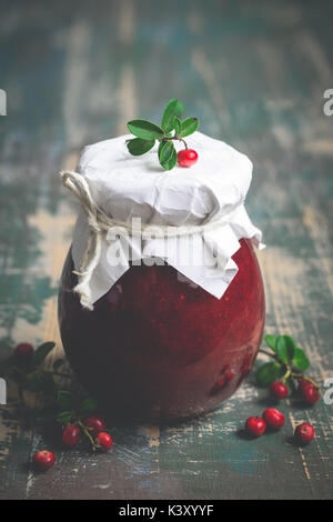 Lingonberry jam in jar and fresh berries. Selective focus  - Stock Photo