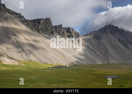 Abandoned Viking village movie set in front of Vestrahorn mountain, Iceland. - Stock Photo