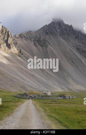 Abandoned Viking village movie set in front of Vestrahorn mountain, Iceland. - Stock Photo