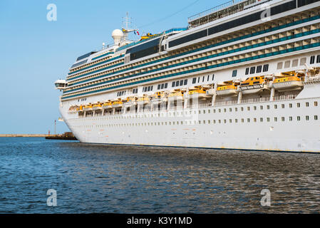 Luxury cruise ship side view showing life boats. - Stock Photo