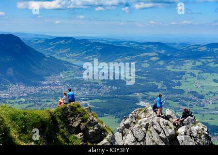 mountain summit Grünten,  view to Immenstadt and lake Großer Alpsee, hiker, Immenstadt, Schwaben, Allgäu, Swabia, - Stock Photo