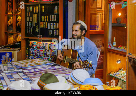 SAFED, ISRAEL - AUGUST 23, 2017: Scene of the Klezmer Festival, with street musician playing, in Safed (Tzfat), - Stock Photo