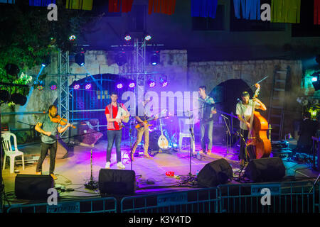 SAFED, ISRAEL - AUGUST 23, 2017: Group of musicians (Gute Gute) play at the Klezmer Festival in Safed (Tzfat), Israel. - Stock Photo
