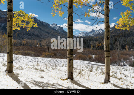 Redcliff and Coxcomb Peak viewed from Cimarron River Valley after early fall snow storm. Located in the Uncompahgre - Stock Photo