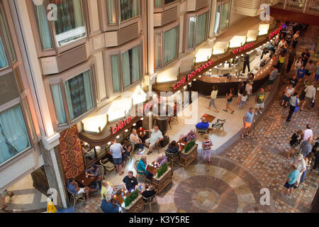 Interior of the Royal Promenade deck of Royal Caribbean Navigator of the Seas cruise ship - Stock Photo