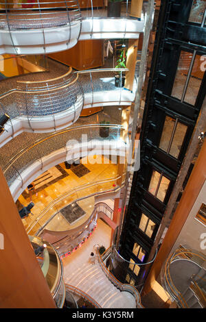 Interior of the Royal Promenade deck of Royal Caribbean Navigator of the Seas cruise ship - Stock Photo