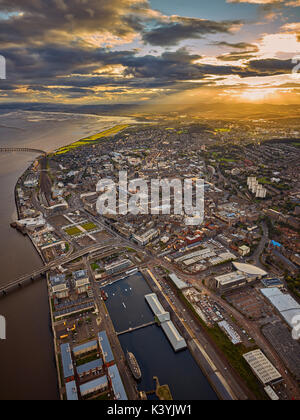 An aerial capture of the City of Dundee as the sun sets over the city - Stock Photo
