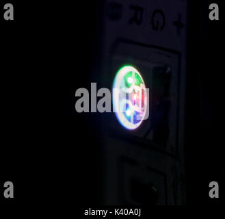 Lit LED strip diode light closeup showing Red, Green and Blue lights - Stock Photo