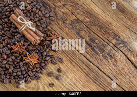 Coffee grains, anise and canella on old planks - Stock Photo