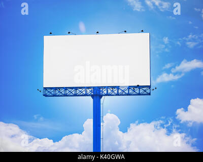 Blank advertisement billboard of blue sky background purposely for adding or applying advertising pictures, graphics, - Stock Photo