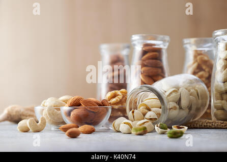 Healthy nuts on wooden background - Stock Photo