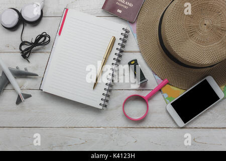 Top view of accessories planning to travel with technology background concept.mix essential item on modern rustic - Stock Photo