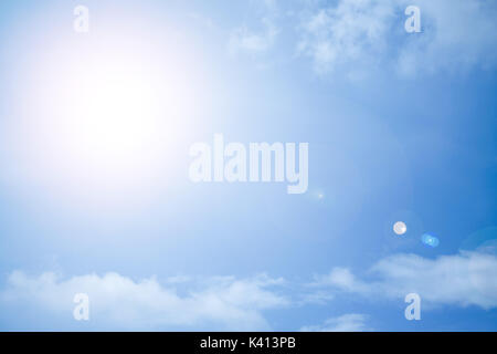The sun shining brightly against the blue sky - Stock Photo