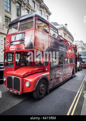 London Tourism - Jack the Ripper open topped tour bus in the City of London financial district - Stock Photo