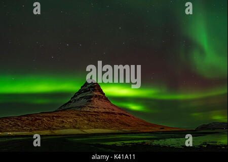 Kirkjufell and Aurora in Iceland - Stock Photo