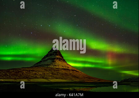 Kirkjufell and Aurora in Iceland - Stock Photo