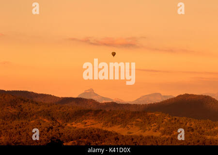 Sunrise from Lamington State Forest with rising balloon - Stock Photo