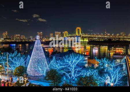 Illuminated Rainbow Bridge in Tokyo,Japan - Stock Photo