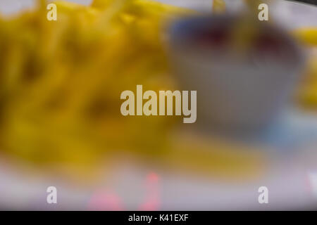 Abstract blurred french fries for background usage. - Stock Photo