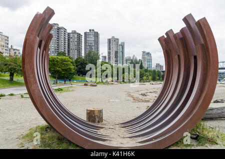 Vancouver, British Columbia Canada, June 14, 2017: Vancouver Skyline through Bernar Venet's  corten steel sculpture - Stock Photo