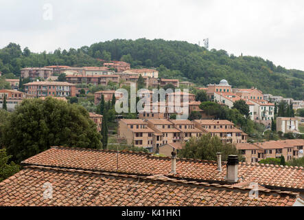 The view over rooftops from the pretty hill town of Montalcino in Val d'Orcia, Tuscany Italy Europe EU - Stock Photo