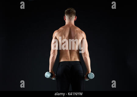 man with dumbbells exercising - Stock Photo