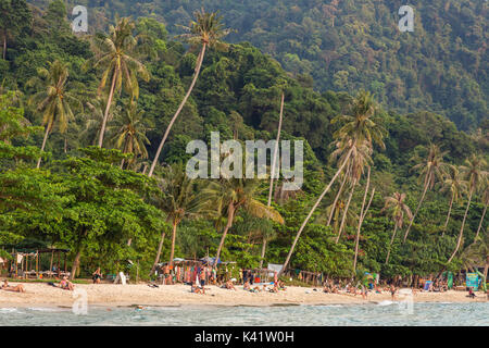 Koh Chang, Thailand - March 19, 2017: Lonely beach on Koh Chang island during sunset in Thailand - Stock Photo