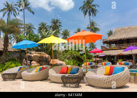 Tropical resort with a swimming pool and cafe bar on Koh Kood island, thailand - Stock Photo