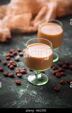 Irish cream liqueur and coffee beans - Stock Photo