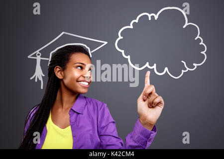 Education in school - schoolgirl idea at cloud - Stock Photo
