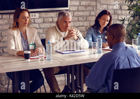 Commission to receive workers talking with potential worker - Stock Photo