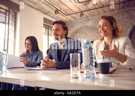 Satisfied three members commission with candidate on job - Stock Photo
