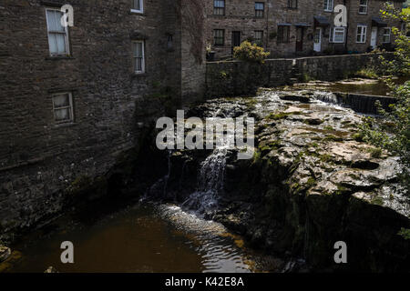 Gayle Beck, river, stream, where it runs between houses in the village of Hawes, Wensleydale, North Yorkshire Dales, - Stock Photo