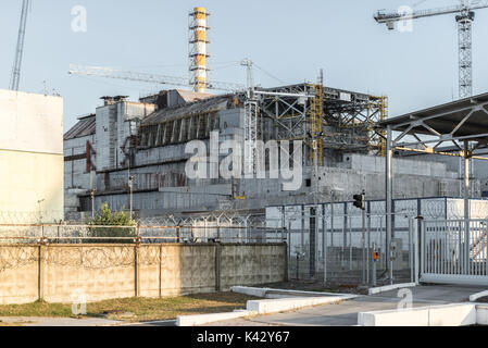 The old sarcophagus over reactor 4 of the Chernobyl Nuclear Power Plant - Stock Photo