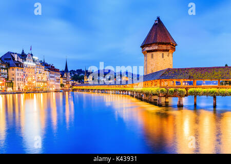 Lucerne, Switzerland. Historic city center with its famous Chapel Bridge and Water Tower.(Vierwaldstattersee) - Stock Photo